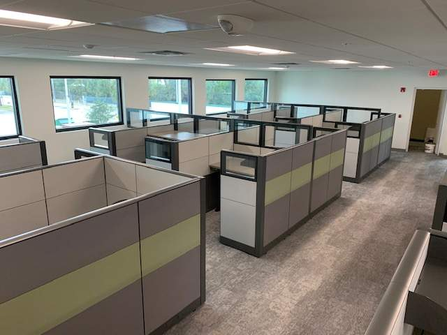 Pre-owned cubicles in business environment